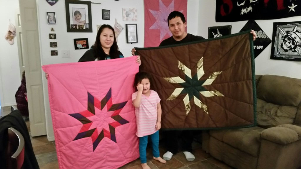 Curtis, Roxanne, and Taylor Stevens holding baby star blankets purchasing from Cree Star Gifts.