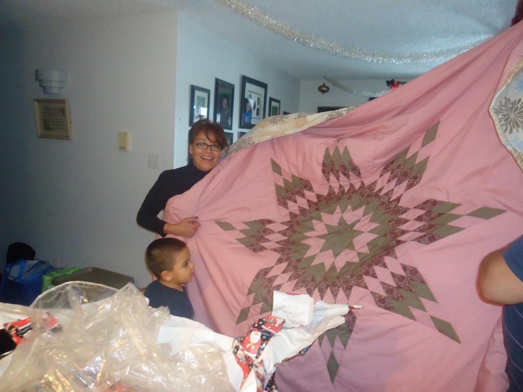 Donna Gorsalitz Saskatoon, Saskatchewan. Holding a Star Blanket
