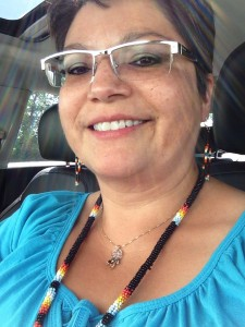 Delores Daniels wearing a pair of Black Beaded Earrings made by Cree Star Gifts.