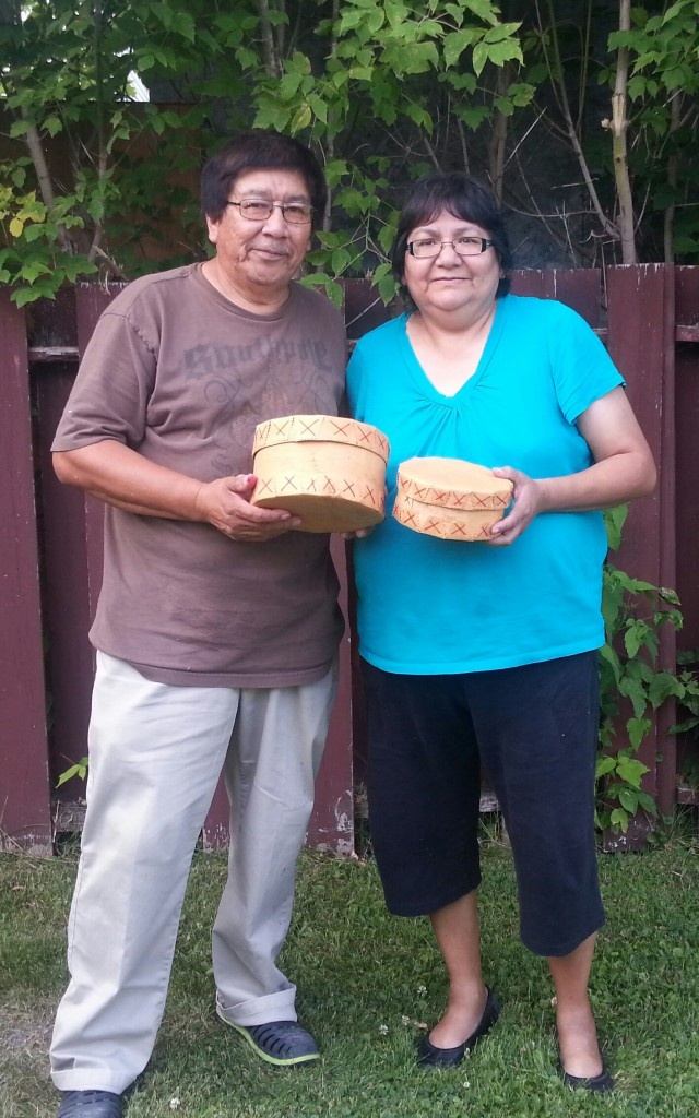 Matthew Sr. (Educator) with his wife, Hilda Garrick. They are holding Birch Bark Baskets purchased from Cree Star Gifts - Cross Lake First Nation.