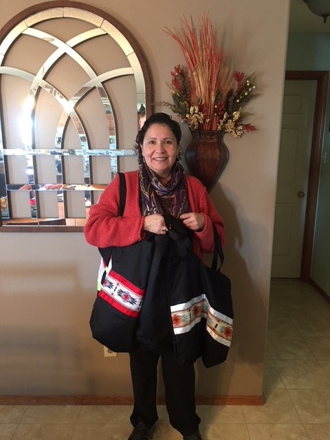 Roxann Smith holding Conference Bags purchased from Cree Star Gifts.