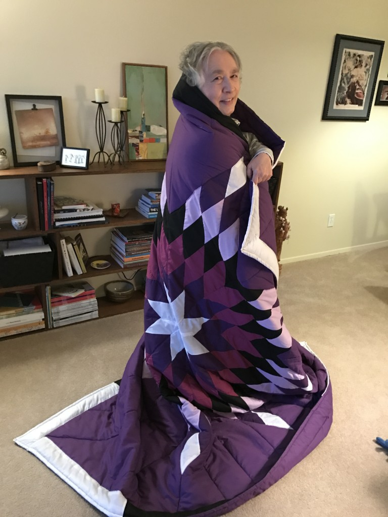Timi Vann's Mother with her star blanket. Timi purchased the blanket from us for her 70th birthday gift.