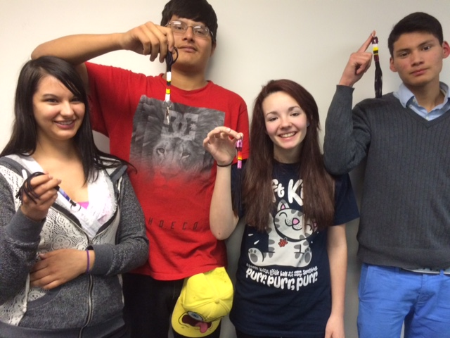High School students holding Beaded Keychains purchased from Cree Star Gifts.