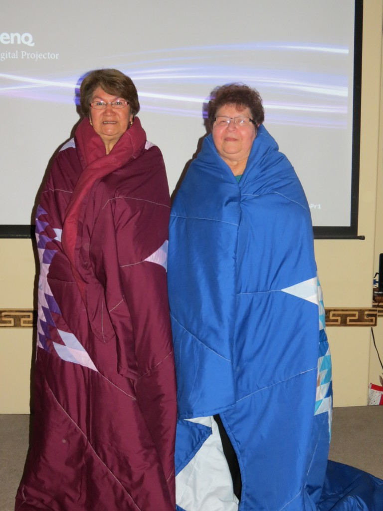 Annette Ells (burgundy blanket) and Bertha Law (blue blanket)