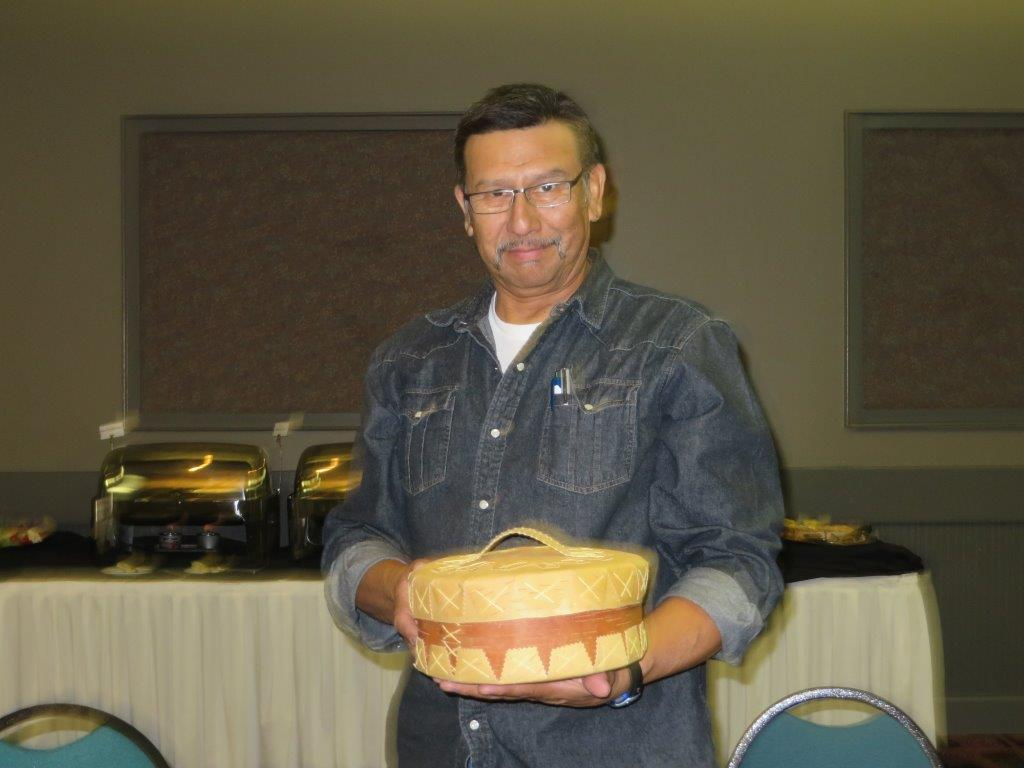 Photo of Chief Billy Joe Laboucan preparing to present a basket to Elder Mike Laboucan of the Lubicon Lake Band in Northern Alberta. www.Plan4ward.ca