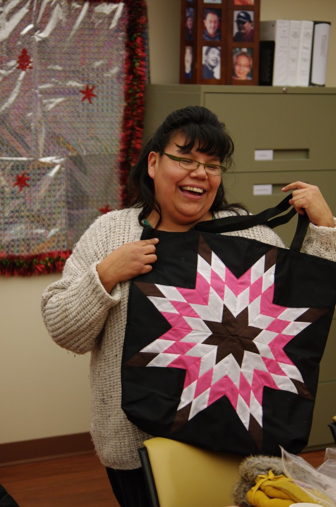 Noelle Halcrow, Community Development Officer, holding one of Cree Star Gifts Star Bags