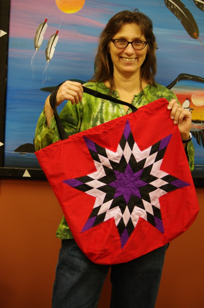 Roseann MacFadgen,- Financial Officer, holding one of Cree Star Gifts Star Bags