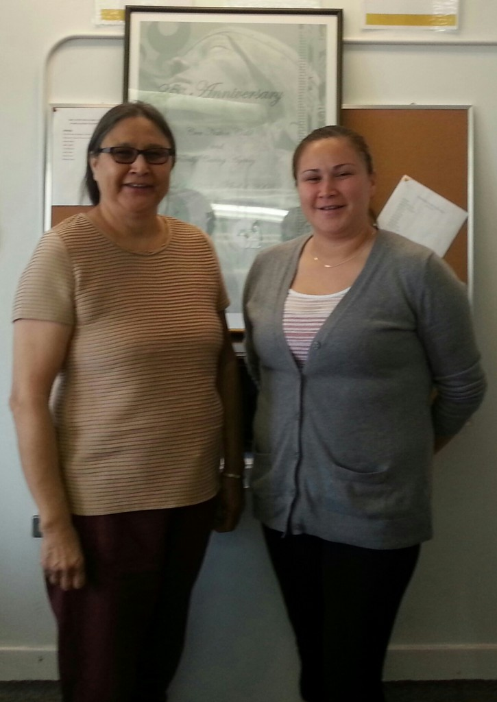 Photo: (left to right) Nora Stevens (CFS Worker), and Sharon Stevens, (Administrative Assistant) at Cree Nation Child and Family Caring Agency in Swan River, Manitoba.