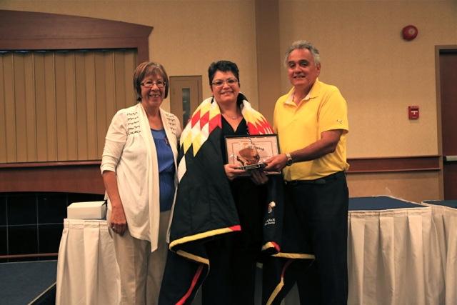 Delores Daniels (center)