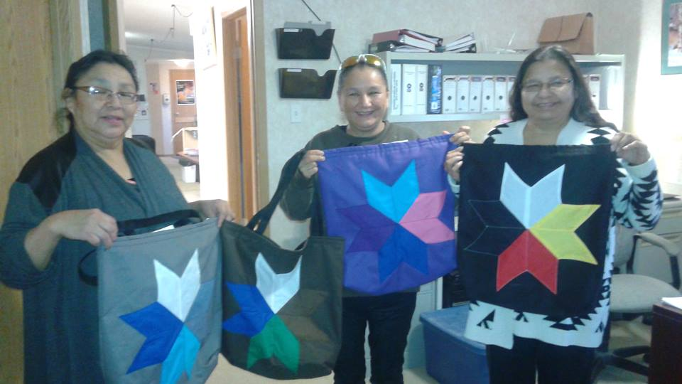 Moose Lake Health Office Staff holding Star Seminar Bags (8 Diamonds) made by us