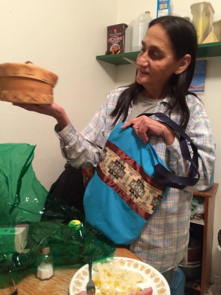 Jeanette's Mother holding Birch Bark Basket & Seminar Bag.