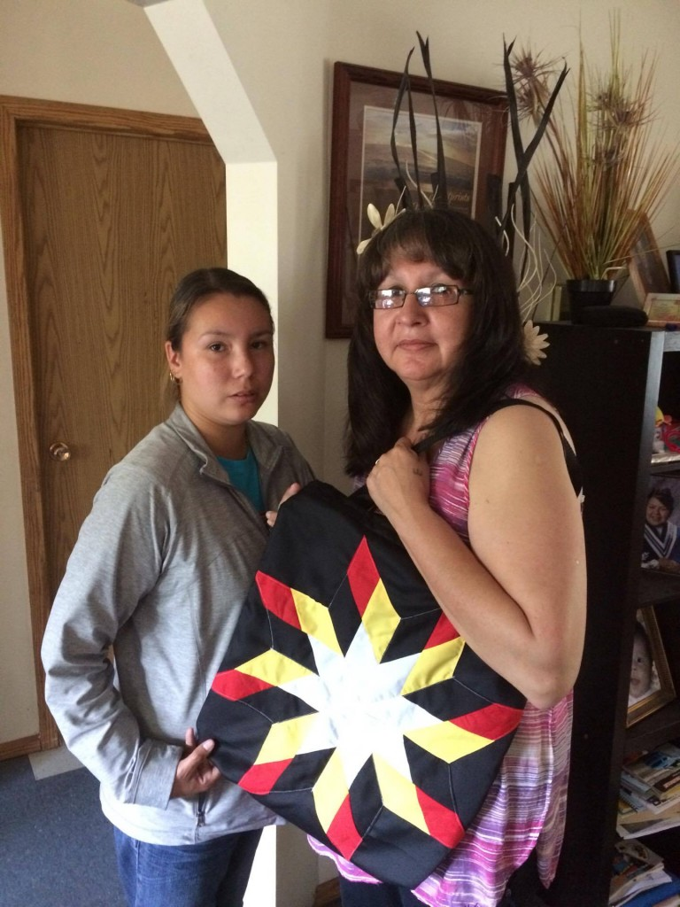 Jenna Hart with her mother. Her mother is holding a Star Bag purchased from Cree Star Gifts for her birthday.