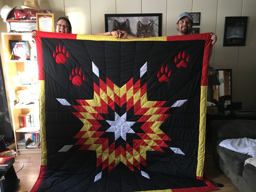 Kevin Settee and Tracy Allan-Young with a Star Blanket purchased from Cree Star Gifts created as an Anniversary Gift from Kevin for his Wife, Tracy.