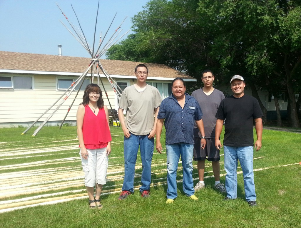 Photo: (left to right) Breanne Massey (Fort Times Reporter), Devereaux Roy, Wendall Starr (Elders Helper), Dylan Roy, John Belanger (Manager & Owner of Cree Star Gifts )