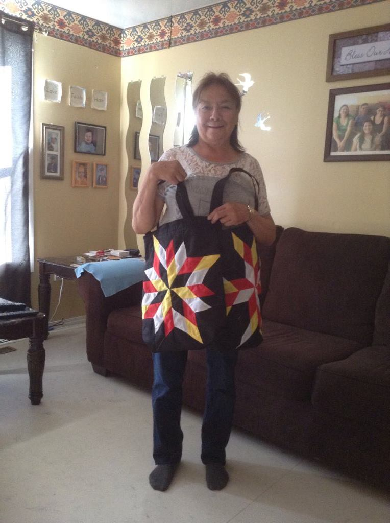 Ruby Garson, holding Star Bags purchased from Cree Star Gifts