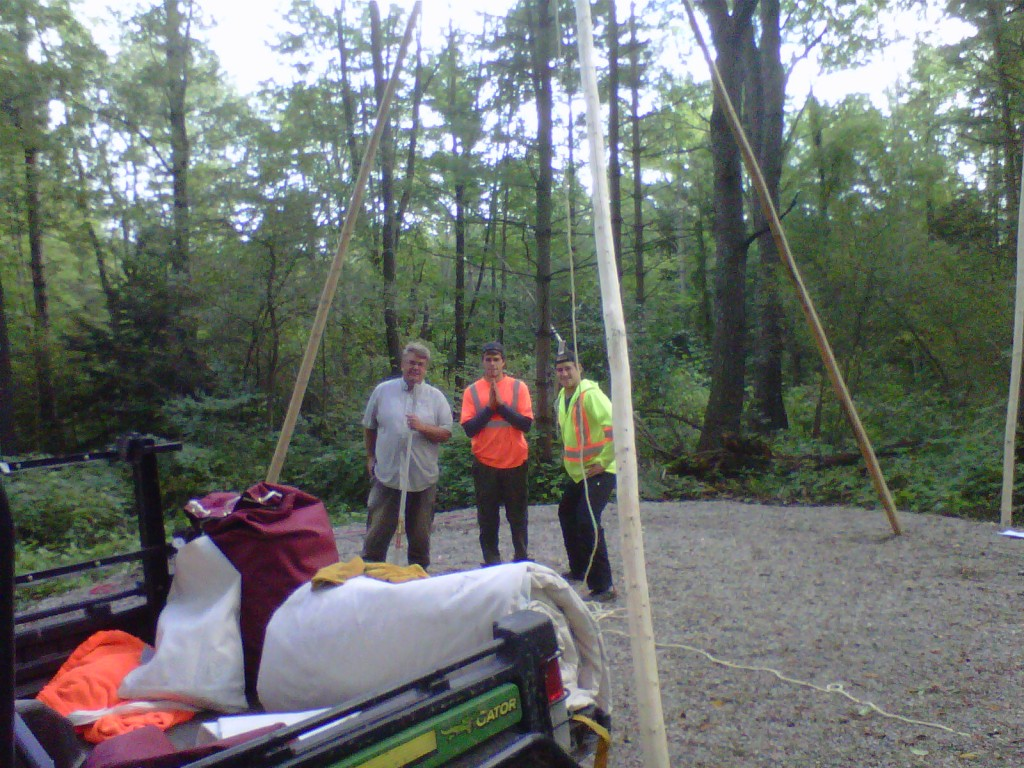 Terry Good and Friends putting up Teepee with Poles purchased from Cree Star Gifts.