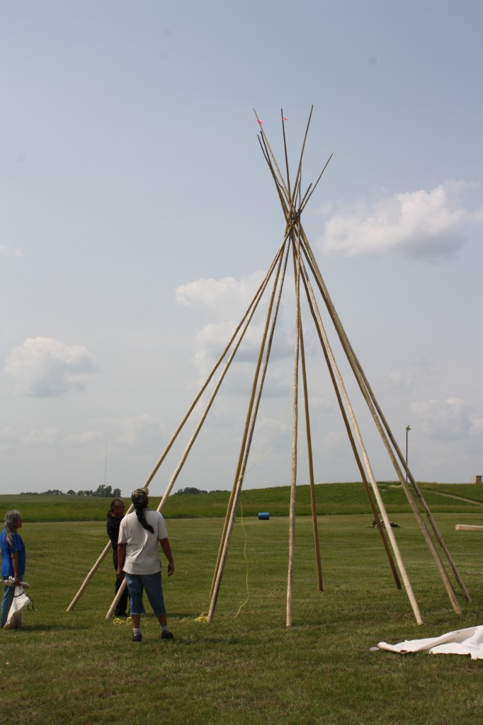 Verna Shannacappo, with other members from Rolling River putting up Teepee's, with Teepee Poles purchased from Cree Star Gifts.