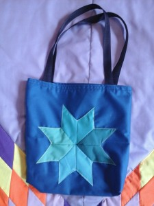 Blue Seminar bag, with four different shades of blue in the star.