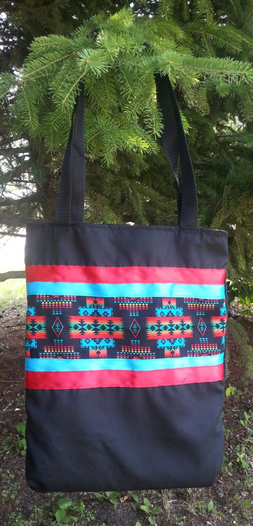Black Bag with Red/Blue Ribbon and Print.