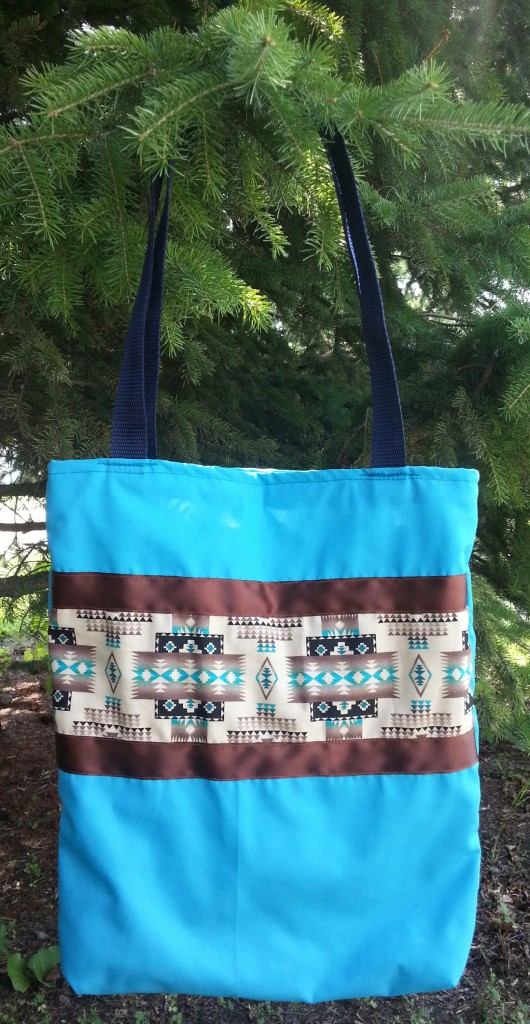 Blue Bag with Brown Ribbon and Print.