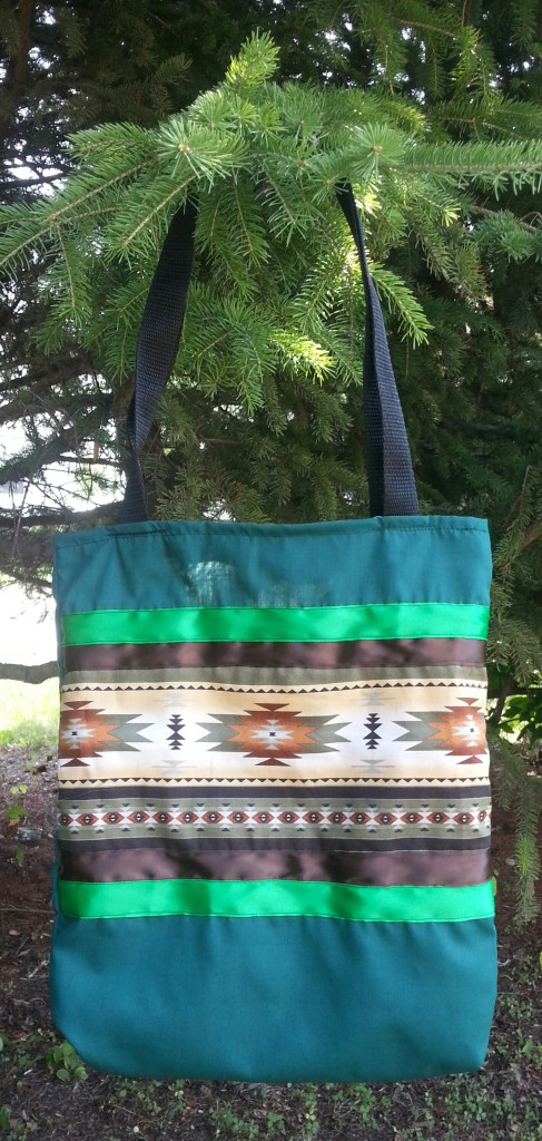 21. Green Bag with Brown/Green Ribbon and Print.