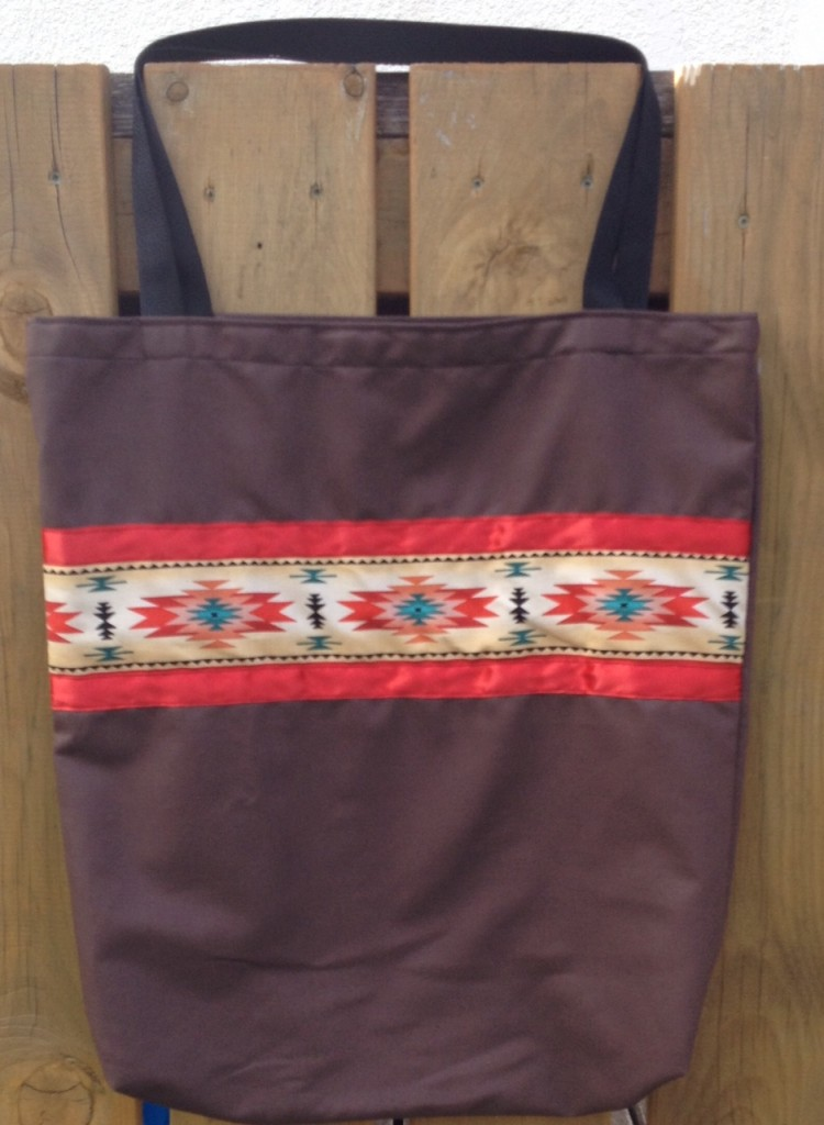 3. Brown Bag with Red Ribbon and Red Print