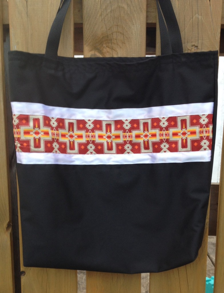 8. Black Bag with Red print and white ribbon