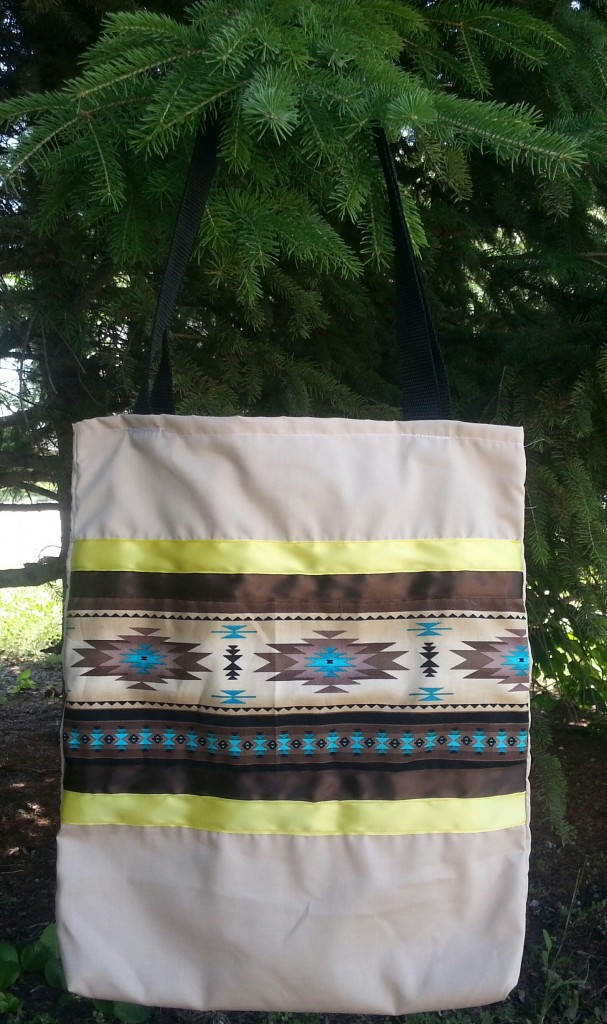 Tan bag with print and brown and yellow ribbon
