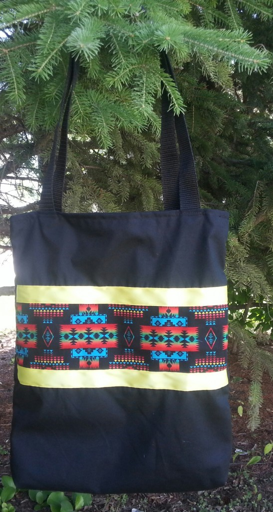 10. Black Bag with print and yellow ribbon