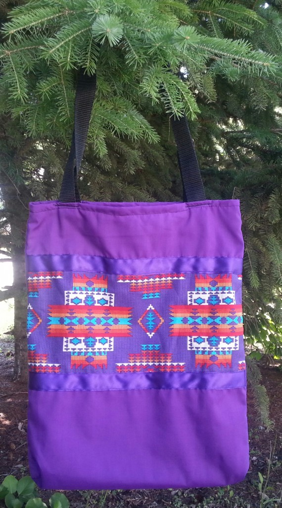 20. Purple bag with print and purple ribbon.