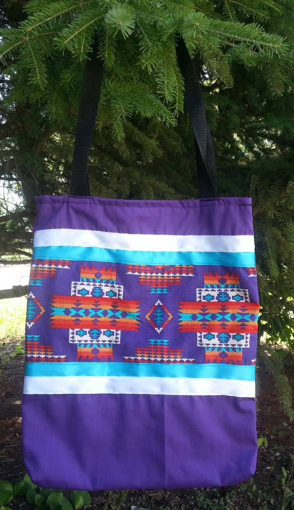 18. Purple bag with print and white and blue ribbon