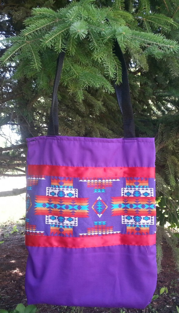 17. Purple Bag with print and red ribbon