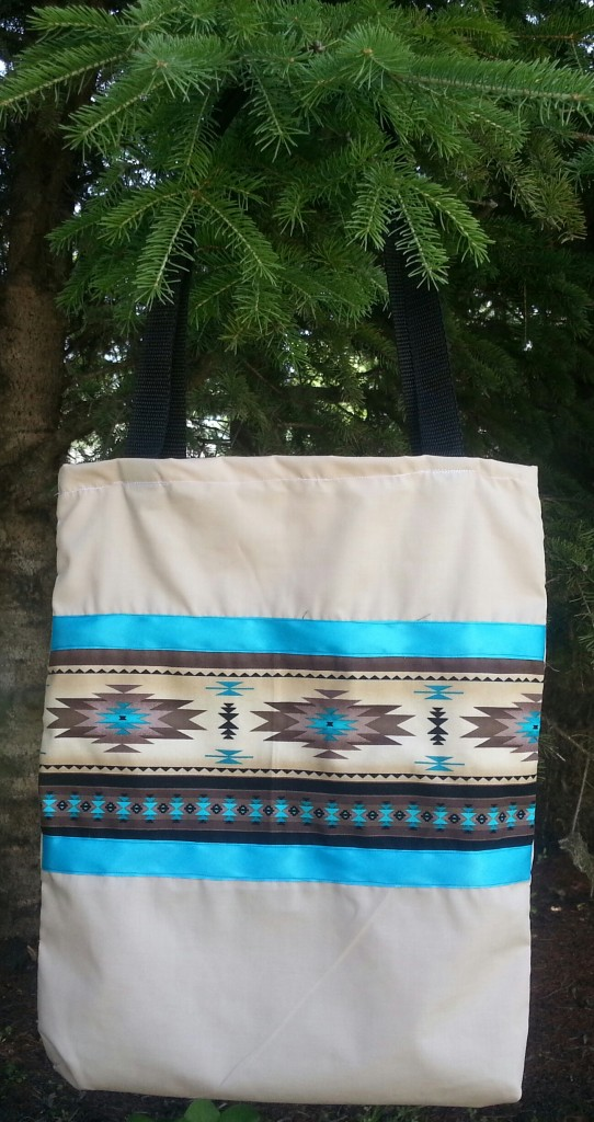 Tan bag with print and blue ribbon