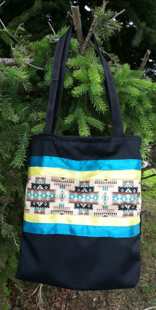 4. Black bag with Navajo print and yellow/blue ribbon