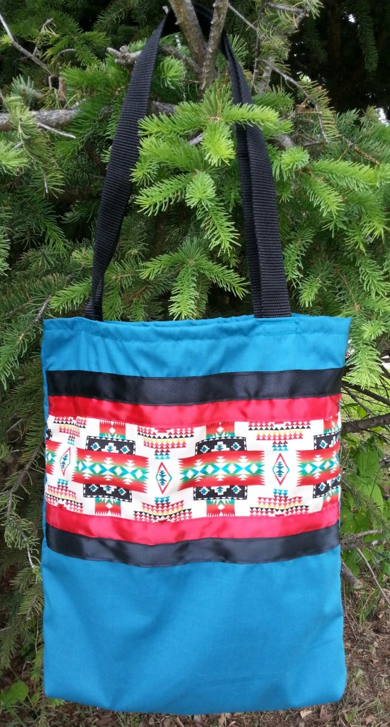 2. Blue/turquoise bag with Navajo print and red/black ribbon