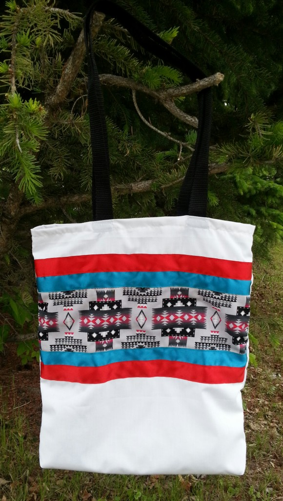 8. White bag with Navajo print and red/blue ribbon