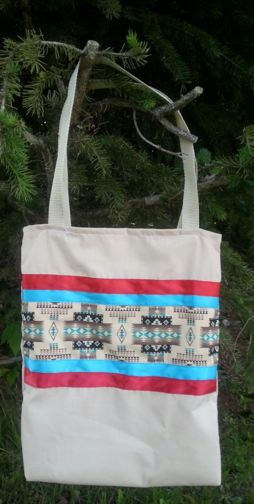 Tan bag with red & blue ribbon.