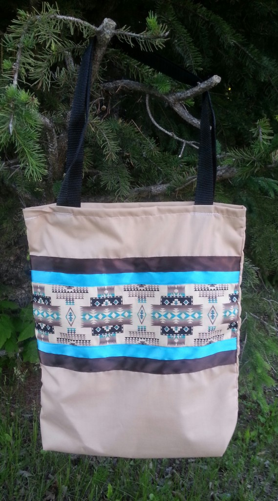 Tan bag with blue & brown ribbon.